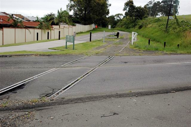 The view looking south where the former Belmont branch line crossed Park Avenue. Apart from the level crossing itself, the rest of the line is now part of the Rail Trail.