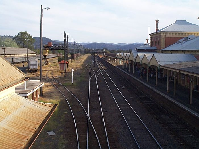 "A view looking south from the overhead foot bridge. The old transhipping yards on the left. Note the ""kinky"" standard gauge 3rd track in the middle distance. The Southern Aurora carriages used for the Southern Steam Spectacular Tour are shown on the left."