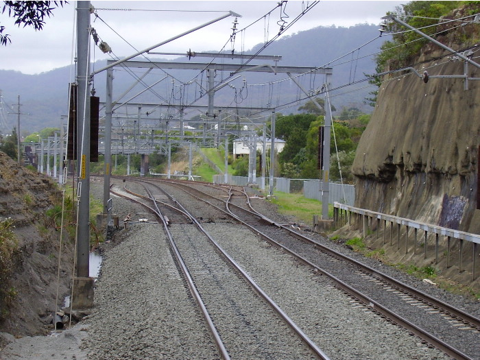 The view through the road bridge arch at the down end of Austinmer station showing the northern entrance to the Thirroul yards.
