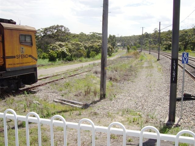 A view from the southern end (Sydney end) of Awaba Station. A rake of track maintenance vehicles are stabled on the former Wangi Wangi branch. A stop block is seen at the end of the truncated track.