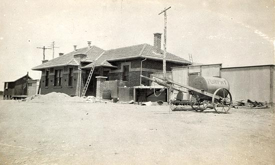 An old photo of the road-side view of the station building.