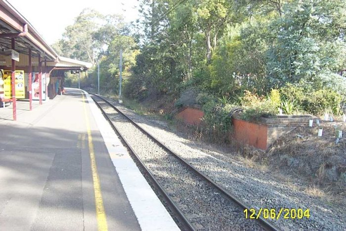 The down platform looking towards Cheltenham showing the old goods platform on the right.