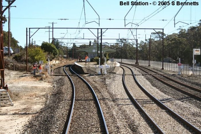 The view looking west towards the Sydney end of Bell platforms. The workers are surveyors and other RIC personnel preparing for upcoming trackwork.