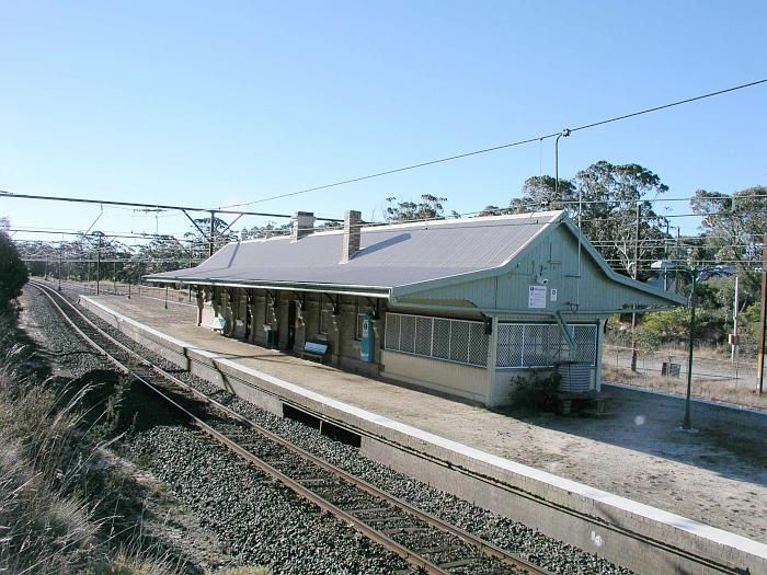 The view looking west across at the station.  The near end of the building was housed the signal box, as evidenced by the opening in the platform.