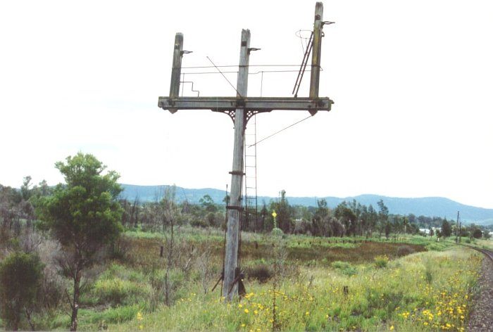 The distinctive 3 arm signal that once stood on the mainline to Cessnock at Bellbird Junction & showed the settings of the various junctions at this location. The gap between the signal post & the surviving line is the site of the down main which was taken out of use between Caledonia & Bellbird Junction in 1973 with the closure of the section to Cessnock and the Bellbird Junction Signal box. With the closure of the signal box the staff machine was transferred to Caledonia.