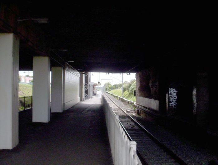 The view from the down end of the station looking under the King Georges Road over-bridge.