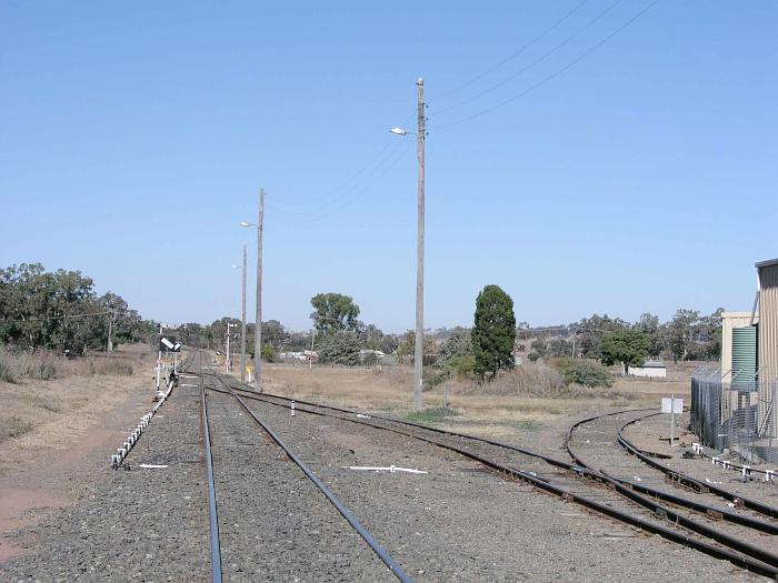 The view looking south from the yard.  In the distance, are the lines to Werris Creek and Merrygoen.  The track on the right is one of the legs of the turning triangle.