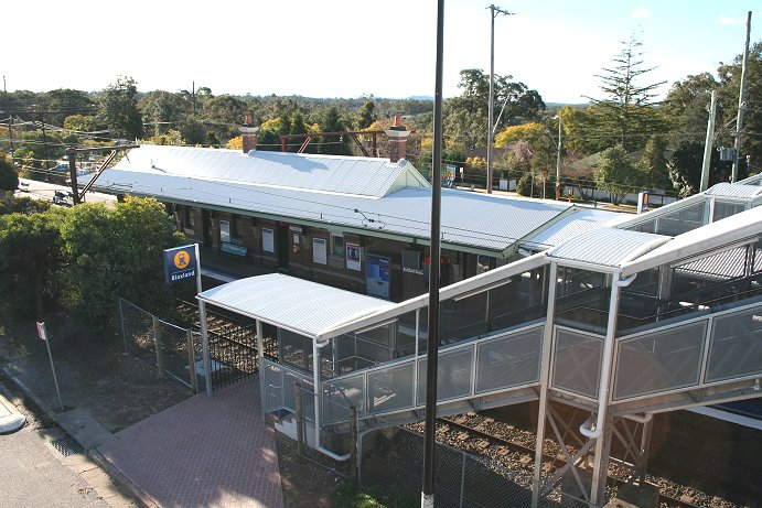 The view from the footbridge after the station was upgraded in 2005 as part of the Easy Access program. The walkway and stairs are now all covered and signage has been modernised.