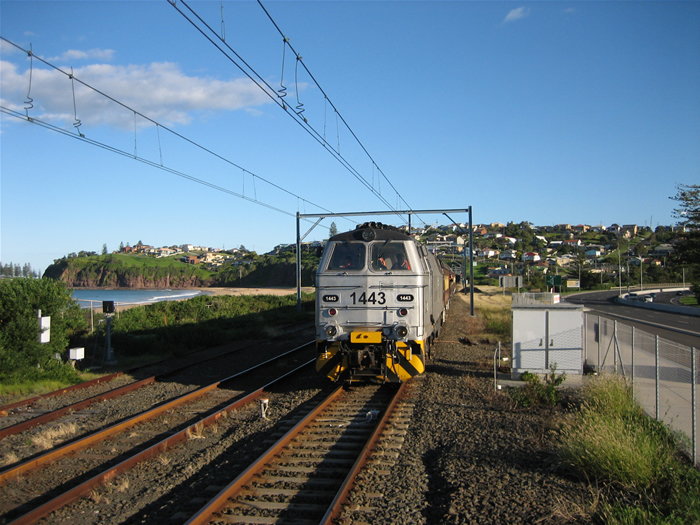 Independent Rail Australia loco 1443 with a tour train approaches Bombo Station from Kiama.