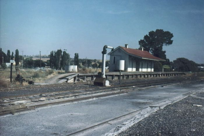 The view looking towards the terminus, showing the station, platform, water columns and lever frame are still present.
