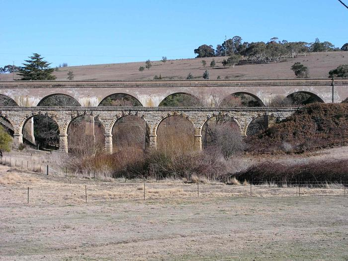 The twin viaducts over Farmers Creek to the west of Bowenfels.  The original is at the front, with the now-deviated track being carried by the newer one at the rear.