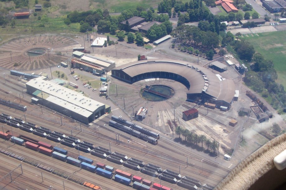 An aerial view showing the Broadmeadow roundhouse and turntables, the Endeavour Sheds and part of the yard. This is the area south of Broadmeadow station.