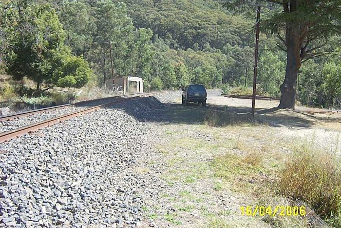 The Up water tank and column is behind the photographer, with the other water tank and column further up around the bend. This photo is looking towards Clandulla. The car is stopped on the location of the former crossing loop track, and near the location of the waiting shed.