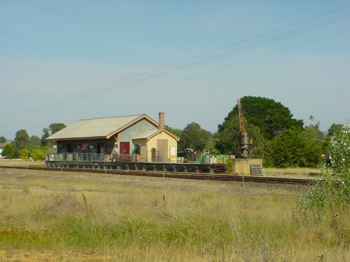 The goods platform, shed and jib crane are still present, south of the main road.