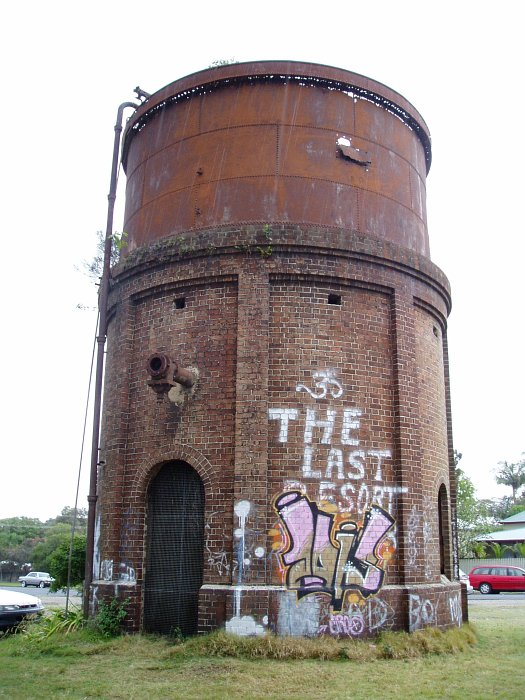 The unusual circular water tank looks to be in poor condition.