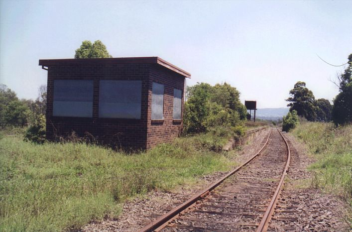 The signal box at the up end is boarded up, and completely stripped inside.