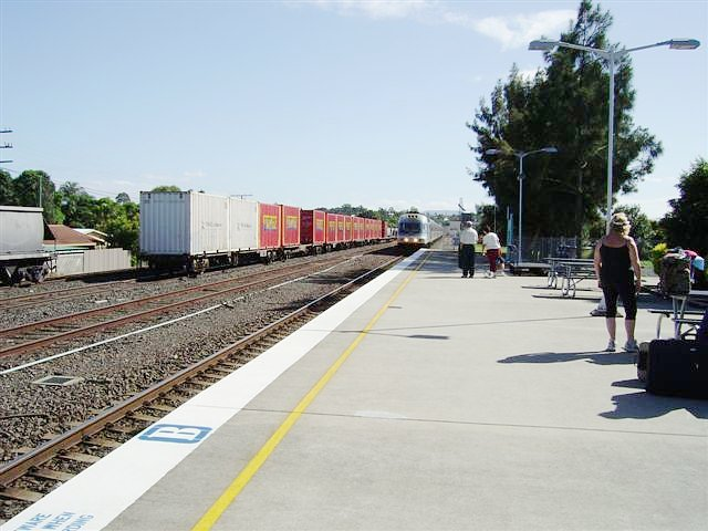 The XPT is approaching from the north, while a northbound goods train waits in the siding.
