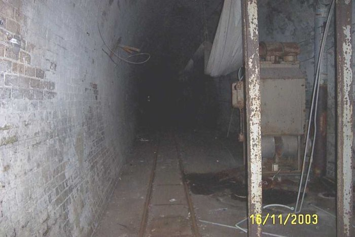 The interior of the tunnel. The small gauge track in the foreground was used by the mushroom farmer to remove the mushrooms to the packing shed. A small converted diesel tractor was used to run along this line.