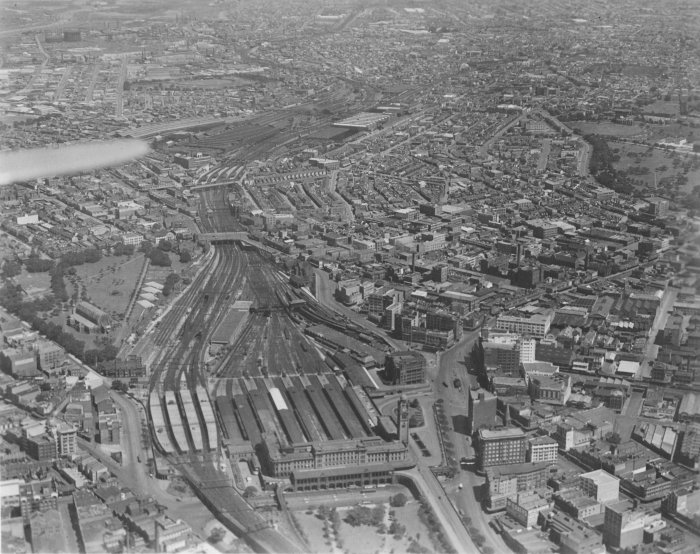 The view looking down from an aeroplane over the Central Station area. In the left foreground are the suburban platforms, with the country platforms on their right. Beyond the second overbridge is Redfern station.
