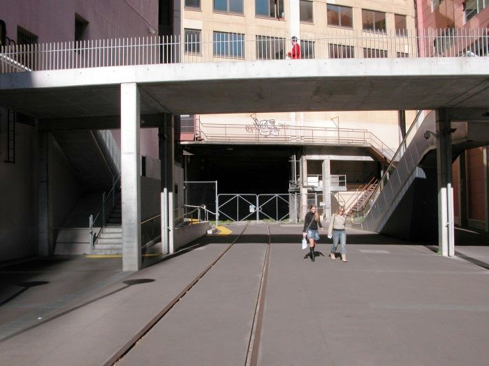 The tunnel under the University of Technology building at Broadway near Central Station. The tunnel was originally double tracked but with both tracks overlapping so trains could not pass in the tunnel. Now only one track is present. The line is a siding of Sydney Yard leading to the Powerhouse Museum that is now part of a combined public walkway and operating railway siding.