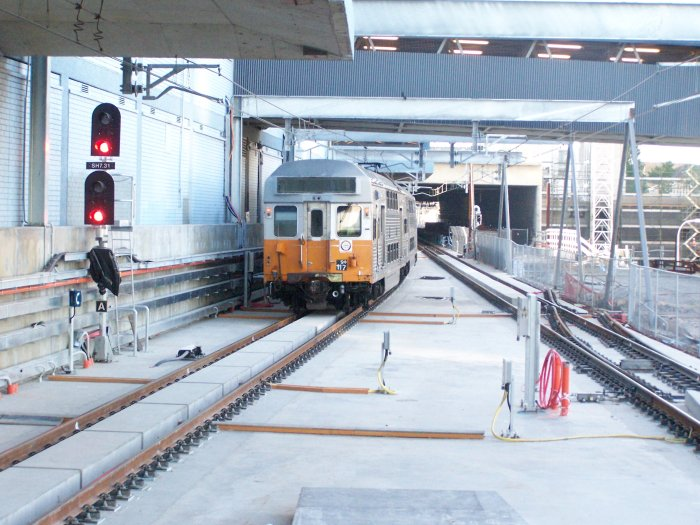 The view north from the end of the platforms, showing the four-track box beyond the station. Also note the half-built crossover.