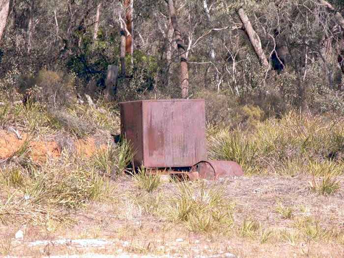 A rusting metal tank sits above the station location.