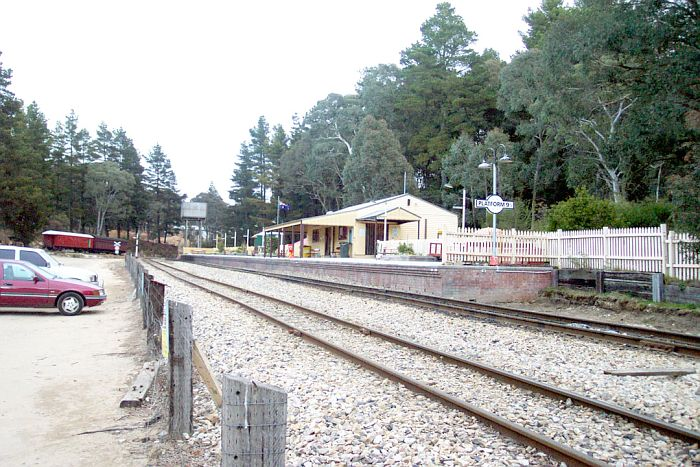 "The view of the station looking towards Lithgow. The sign on the near end reads ""Platform 9 3/4""; it is part of the ""Hogwarts Express"" tourist campaign."