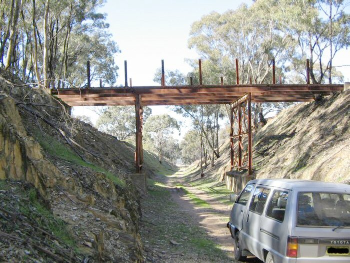 An incomplete road overbridge in the Comobello - Spicers Creek section. This section of the formation is used by local farmers to access their properties. The view is looking along the track in the direction of Gulgong.