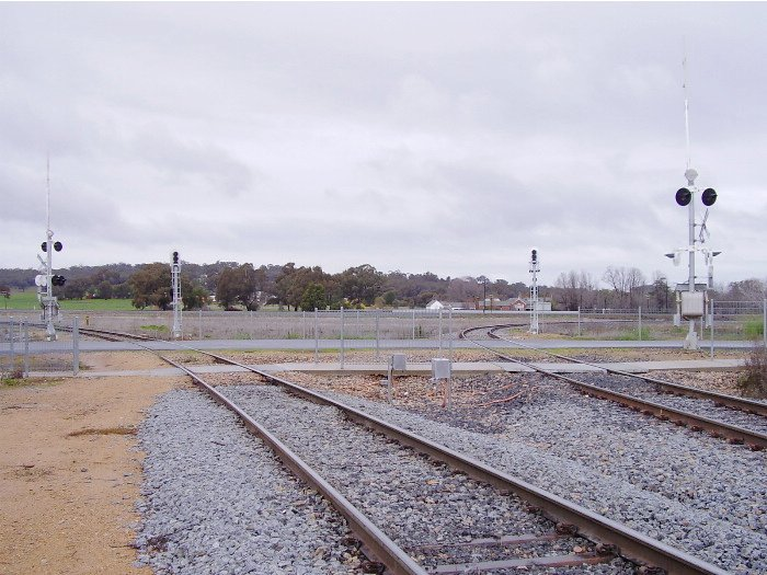 The northern and southern arms of the Cootamundra triangle showing the two level crossings over the Olympic Highway at Cootamundra West - a view looking south-east.