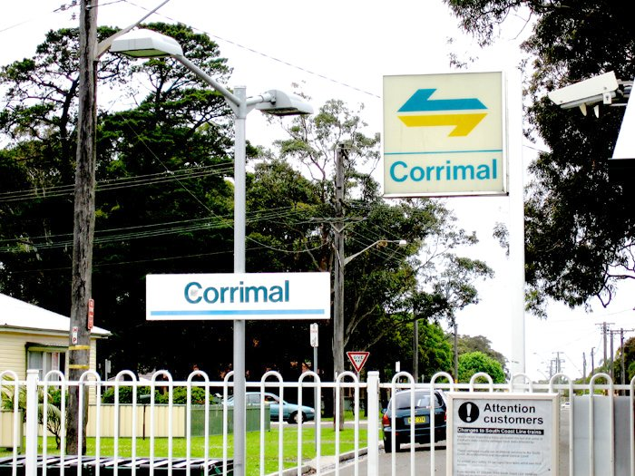The old white CityRail style station signs at Corrimal.