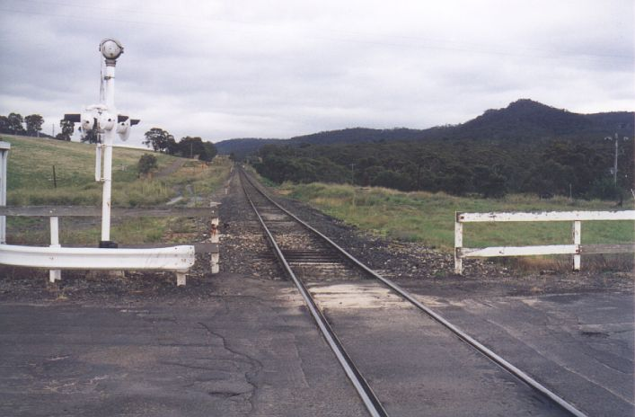 The grass mound on the right side of the line is the location of Cullen Bullen station, in this view looking north.  No trace remains today.