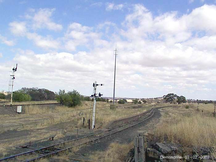 The overgrown branch line platform is still present, along with a pair of semaphore signals.