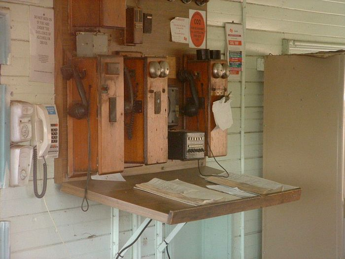 A close-up view of the signalling telephones and log books.