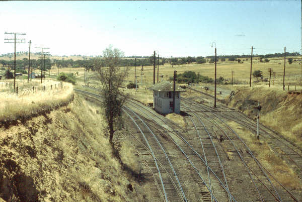 A view looking down to Albury where Demondrille North Box can be seen and also the two separated platforms, the one from the branch on the right.