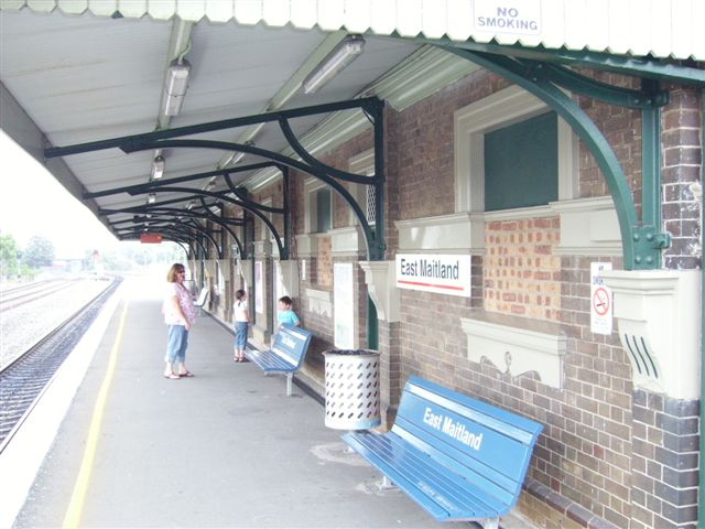 The bricked-up windows of the now unattended East Maitland station . This view of the island platform looking towards Maitland. The  two lines on the extreme left are the Coal Roads.