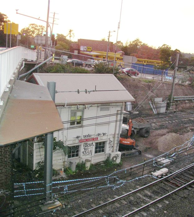 The signal box with adjacent earthmoving equipment.