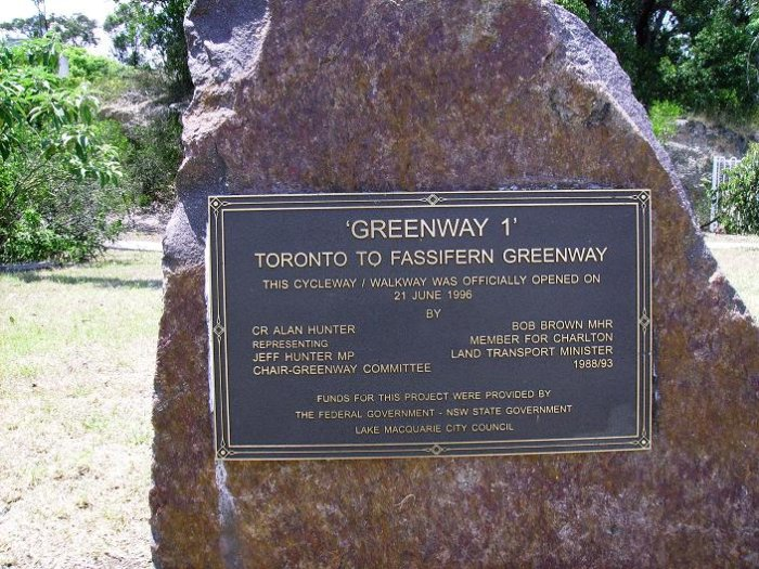 A plaque commemorating the opening of the former branch line to Toronto as a cycleway.