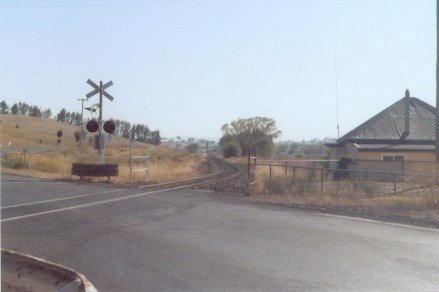 The level crossing at the up end of the location.