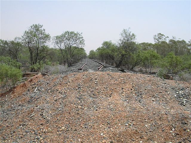 The view looking north towards Bourke.  The line has been cut to cater for the road to the nearby property of the same name.