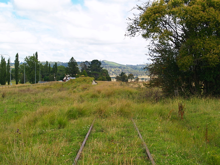 The view looking south. Beyond the goods ramp were the goods shed and station, both on the left side of the track.