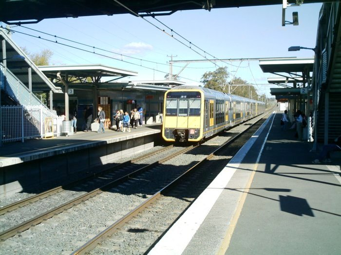 A Tangara leaving platform 3 heading to Macquarie Fields, on the Down main.