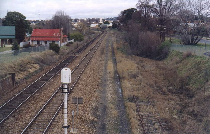 Looking south towards Goulburn, the overgrown Crookwell line sits on the right hand side.  The junction was just before the curve in the distance.