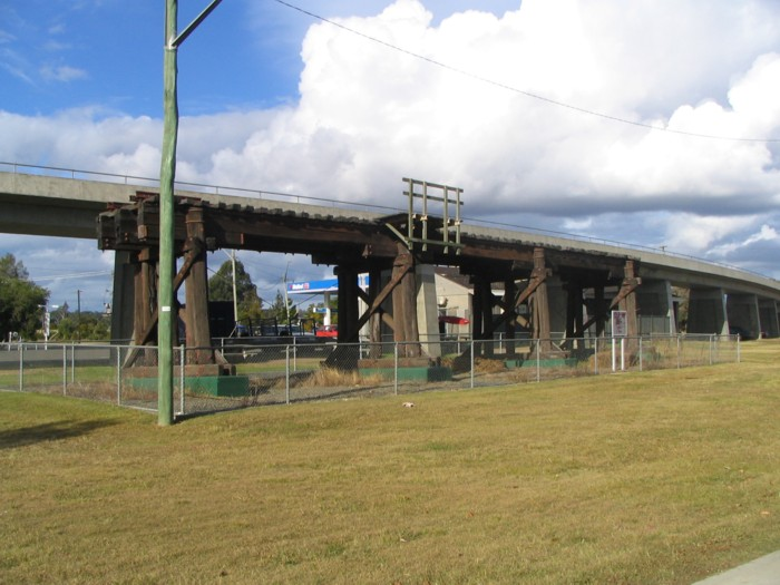 Three timber spans of the original South Grafton viaduct lie adjacent to the line not far to the south of Grafton City station.