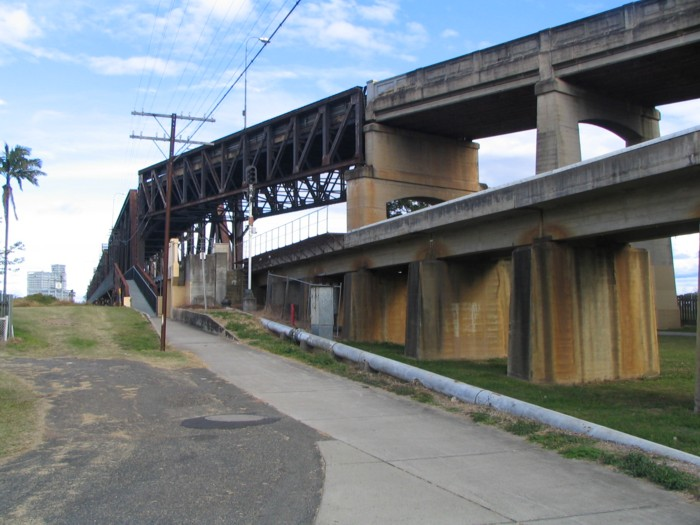 Road (above) and rail (below) converge at the northern end of the Grafton Bridge.