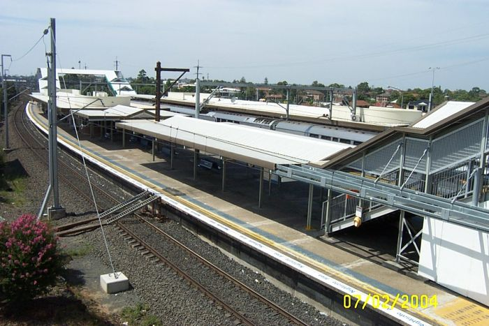 The view from the pedestrian bridge looking along platform 1 towards the city.