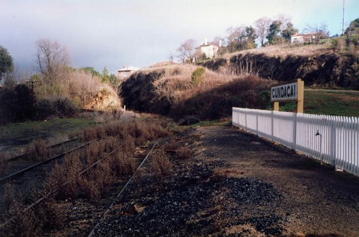 The view of the collapsing platform and the track extending towards the bridge over the Murrumbidgee River.