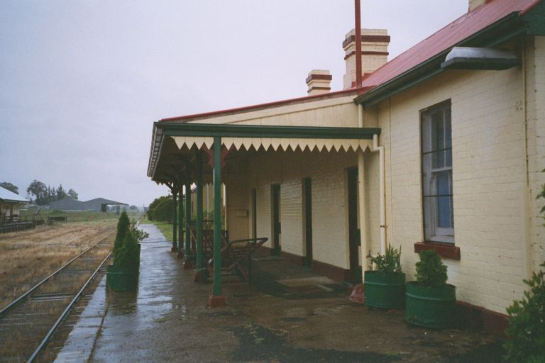 The view along the platform showing the well-preserved station building.