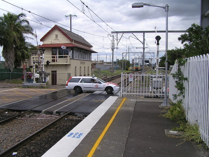 The view looking west from the down end of the station.  The track curving behind the signal box leads to the Mill Siding.  The Endeavour set in the distance is just passing through Hamilton Junction.