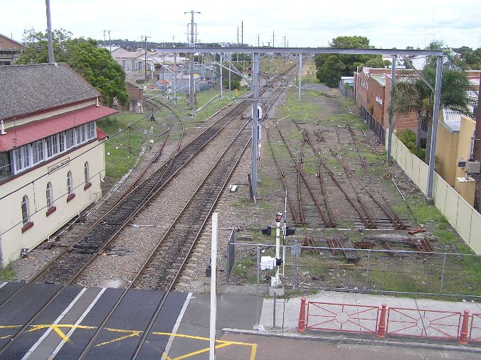 An elevated view looking west.  The Mill Siding is in the left foreground, with Hamilton Junction visible in the distance.  The tracks on the right are the remains of the sidings which were at the start of the short Wickham branch.