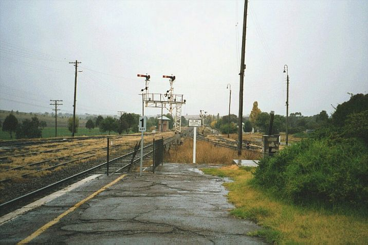 The view from the north end of the station, showing the semaphore signals and Harden North signal box in the background.